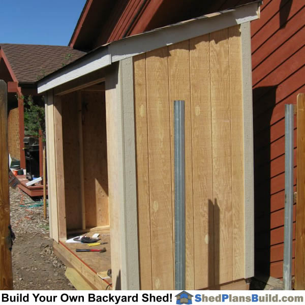 Trim is installed on shed corners and fascia.