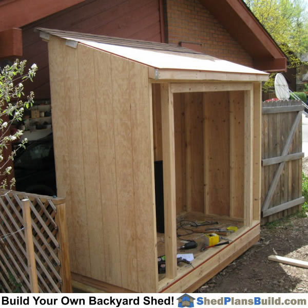 Roof sheeting is installed on lean to shed roof.